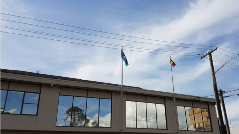Reconciliation Week flying Aboriginal and Torres Strait Islander flags at NCCH